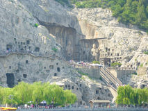 Tourists traveling Longmen Grottoes Stock Image