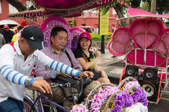 Tourists traveling in a rickshaw in Malacca Royalty Free Stock Photo