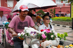 Tourists traveling in a rickshaw in Malacca Royalty Free Stock Image
