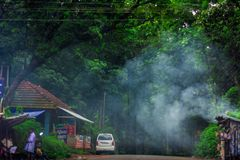 Tourists are traveling to Vagamon hill station by car. Vagamon road, Idukki, Kerala, India- 07 July 2019: Tourists are traveling to Vagamon hill station by car royalty free stock photography