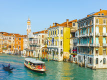 Tourists travelling on gondolas and boats on Grand Canal Stock Image