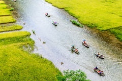 Tourists travelling on a stream with ripen rice strips on both sides of a stream insides Stock Images