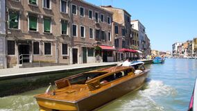 Tourists travelling by water taxi along Venice canal, transportation services. Stock footage stock footage