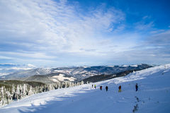 Tourists trek in Carpathians Royalty Free Stock Photo