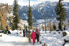 Tourists Trekking in Himalayas in Winter Royalty Free Stock Photo