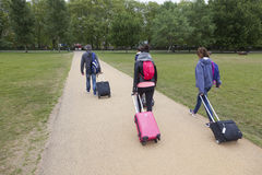 Tourists with trolleys in london hyde park Royalty Free Stock Images