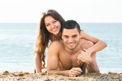 Tourists on a tropical beach. Two young tourists on a tropical beach summer day Royalty Free Stock Photo