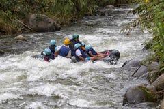 Tourists tubing on the Mindo river in Ecuador Royalty Free Stock Photo