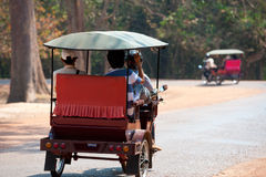 Tourists on tuctucs at Angkor, back view Royalty Free Stock Photography
