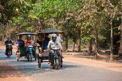 Tourists on tuctucs at Angkor Royalty Free Stock Photo