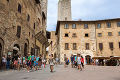 Tourists in the Tuscan Village of San Gimignano, Italy Stock Photo