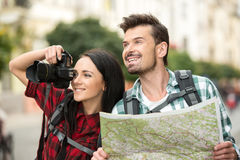 Tourists. Two young tourists with backpacks, touristic map and camera. Sightseeing City Stock Photography