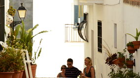 Tourists in a typical street of Andalusia. Tourists in a typical andalusian village walking stock video footage