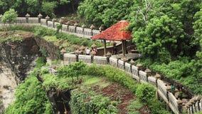 Tourists at Uluwatu paths stock footage