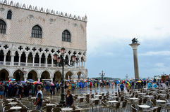 Tourists with umbrellas in St Mark`s square in a raining day, Venice, Italy. Stock Images