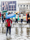 Tourists with umbrellas St Marks Sq. Venice Royalty Free Stock Photo
