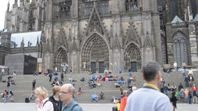 Tourists under the Cologne cathedral Stock Photo