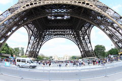 Tourists under Eiffel tower Stock Photo