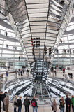 Tourists under  Reichstag dome Stock Photo