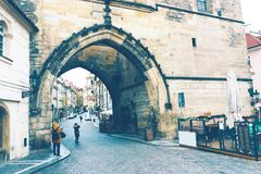 Tourists under the tower on the Charles Bridge royalty free stock photo