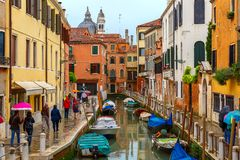 Tourists under umbrellas on a rainy day in Venice Royalty Free Stock Image