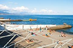 Tourists on urban beach in Alushta city Stock Photos