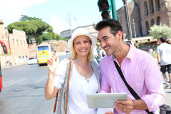 Tourists using a digital tablet in street of Rome Royalty Free Stock Images