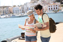 Tourists using gps and map Stock Images
