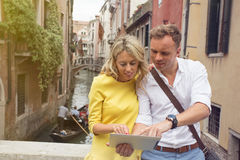 Tourists using tablet computer Royalty Free Stock Photo