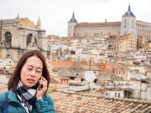 Tourists using telephone at Toledo, Spain Stock Photo
