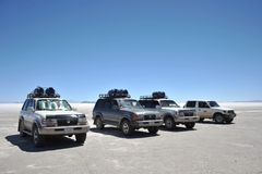 Tourists on the Uyuni salt flats, dried up salt lake in Altiplano Stock Photo