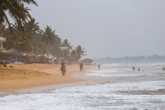 Tourists vacationing on the beach in Sri Lanka Royalty Free Stock Photo