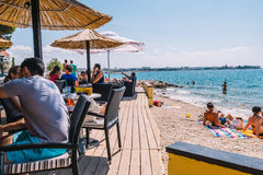 Tourists and various guests sitting at the bar by the sea and enjoy the sun in Zadar Stock Photography