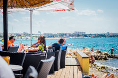 Tourists and various guests sitting at the bar by the sea and enjoy the sun in Zadar Stock Photos
