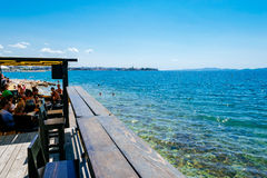Tourists and various guests sitting at the bar by the sea and enjoy the sun in Zadar Royalty Free Stock Image