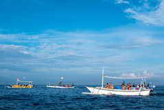 Tourists in various small boats looking for dolphins in Lovina, Stock Images