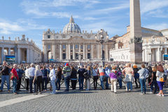 Tourists in Vatican. Vatican, Italy - November 7, 2015: The Papal Basilica of St. Peter and its square with tourists Stock Images