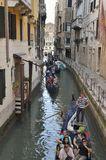 Tourists on Venetian gondolas Stock Photo