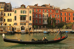 Tourists in Venice. Gondola with tourists on Grand Canal in Venice, Italy Royalty Free Stock Photo