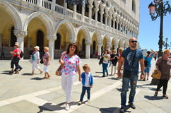 Tourists in Venice,Italy. Tourists fashion family  near the Doges  Palace    in  Venice,Italy Stock Photos