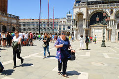 Tourists in Venice,Italy. Tourists on Piazza san Marco  near the Doges  Palace    in  Venice,Italy Royalty Free Stock Images
