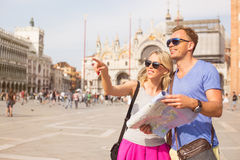 Tourists in Venice looking for directions royalty free stock photo