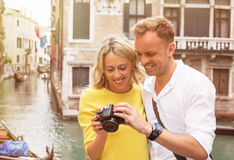Tourists in Venice looking at pictures on digital camera Stock Images