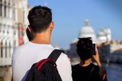Tourists in Venice taking photos royalty free stock photo