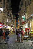 Tourists on Via San Cesareo in Sorrento, Italy at night Stock Image
