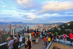Tourists at Victoria Peak, Hong Kong. HONG KONG - JULY 19 : Tourists visit the Peak Tower on July 19, 2012 in Hong Kong. The Peak is the most popular attraction Stock Photography