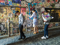 Tourists view Ghost Alley grafitti wall, Seattle, Washington. Seattle, WA, May 17 2016: Tourists view grafitti wall at Ghost Alley, near Pike Place Market stock images