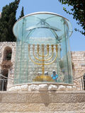 Tourists view and photograph Menorah - the golden seven-barrel lamp - the national and religious Jewish emblem near the Dung Gates Stock Image