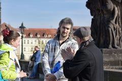 Tourists view Prague from Charles Bridge Stock Image