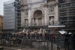 Tourists view repairs of Trevi Fountain, Rome. Stock Photography